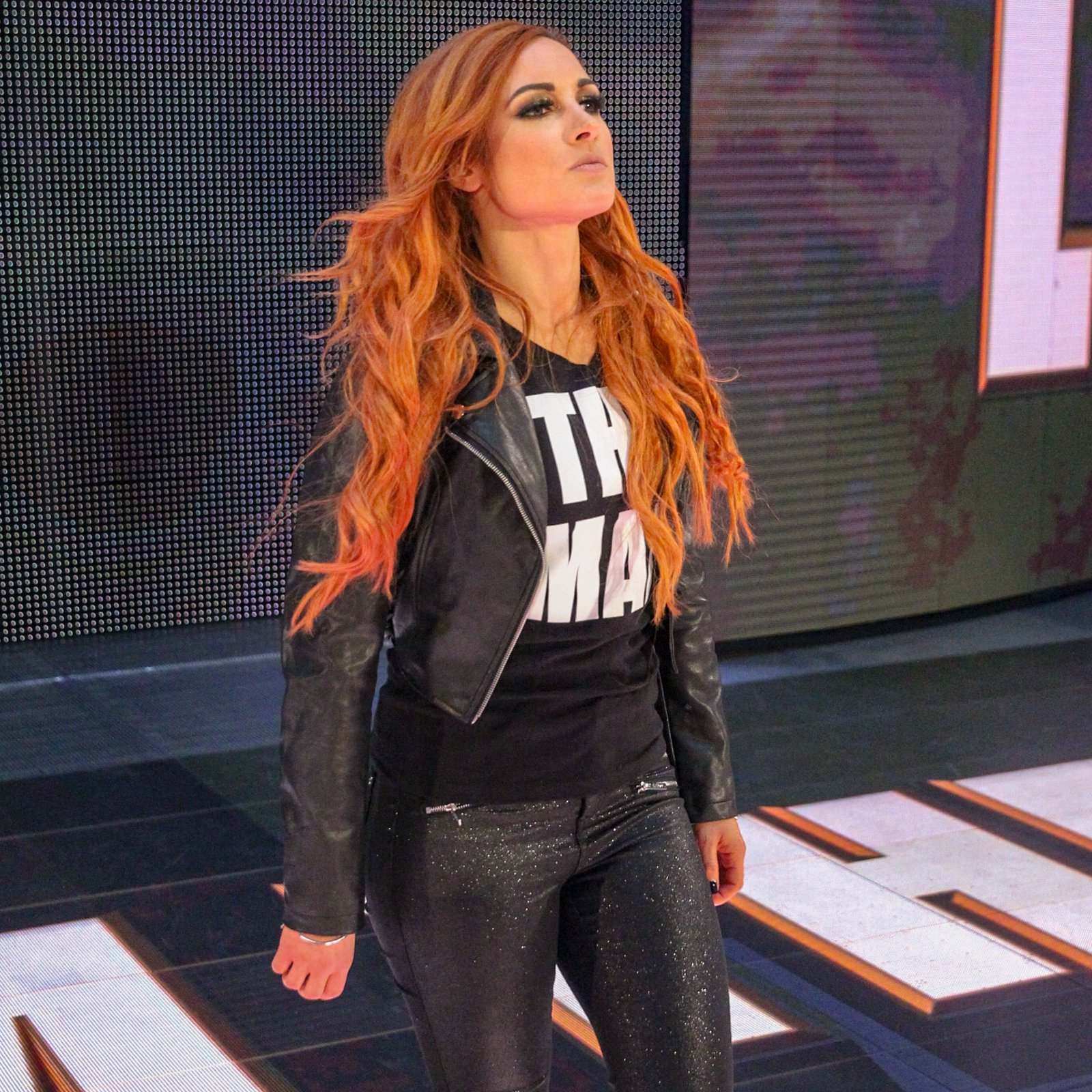 Finally, SmackDown Women's Champion Becky Lynch is all business as she joins her two challengers in the ring.