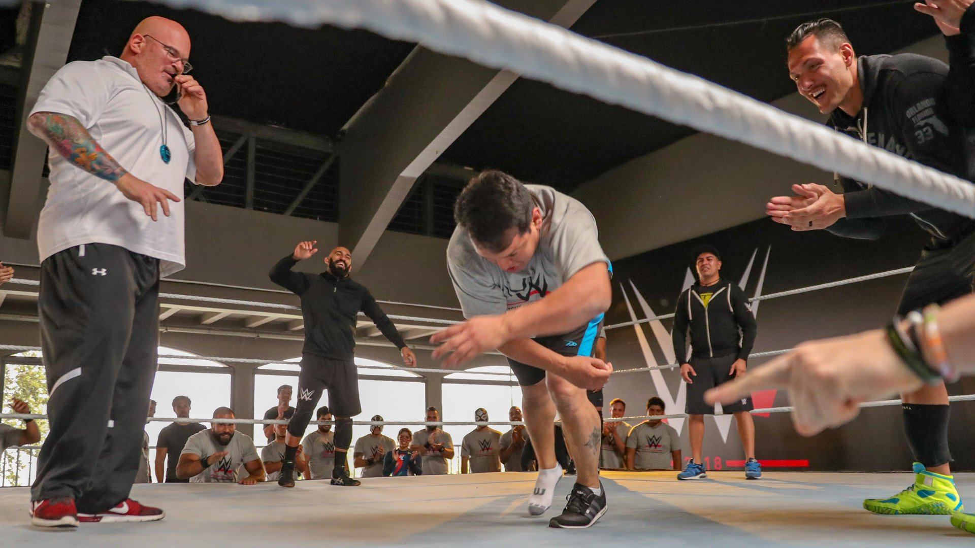 WWE Performance Center Head Coach Matt Bloom and the NXT Superstars cheer on Ricky Marvin, one of the tryout's most experienced and best known luchadores, as he completes a roll despite losing his right shoe.