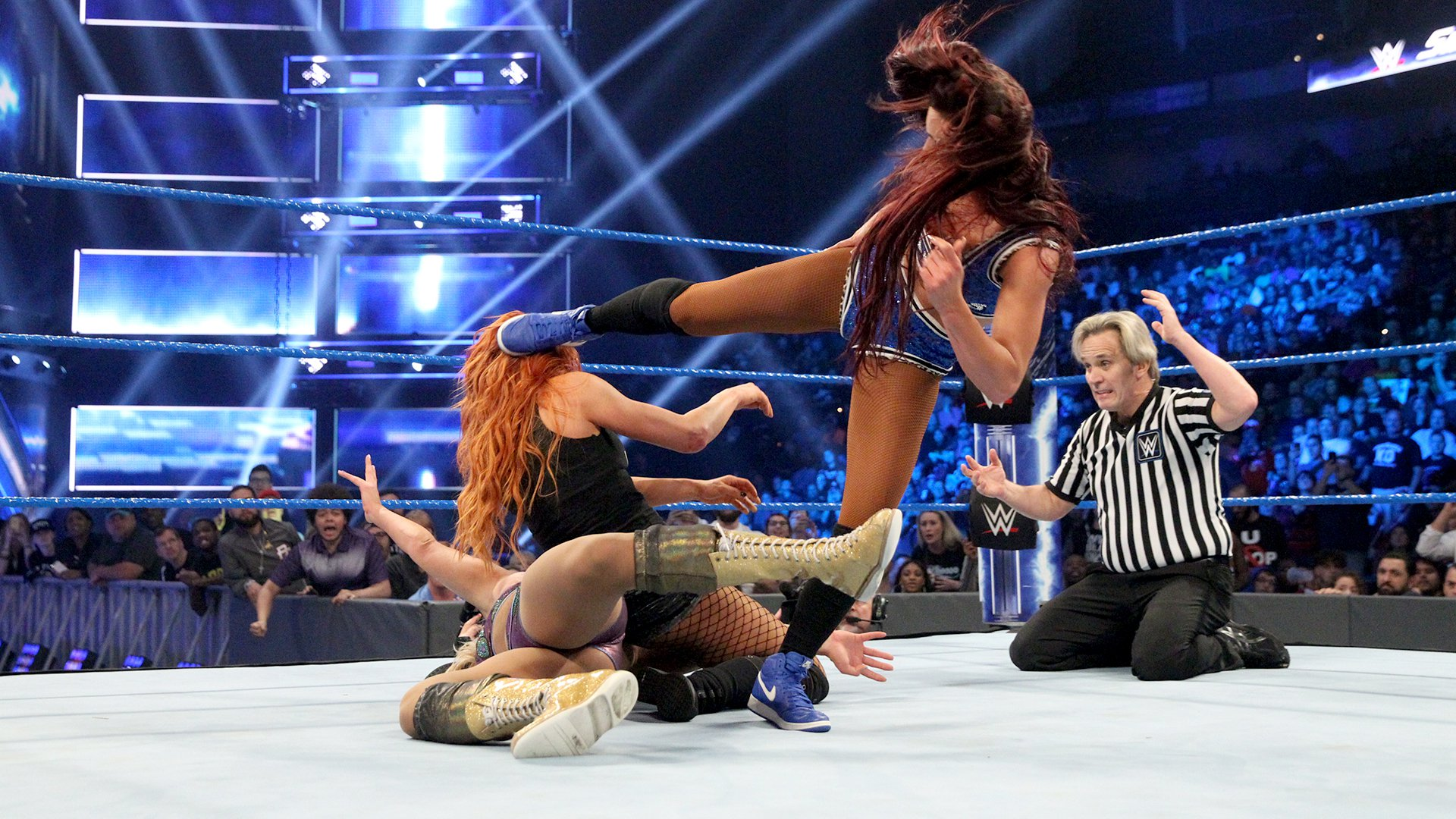 Becky goes for the Dis-arm-her, but Carmella breaks it up.