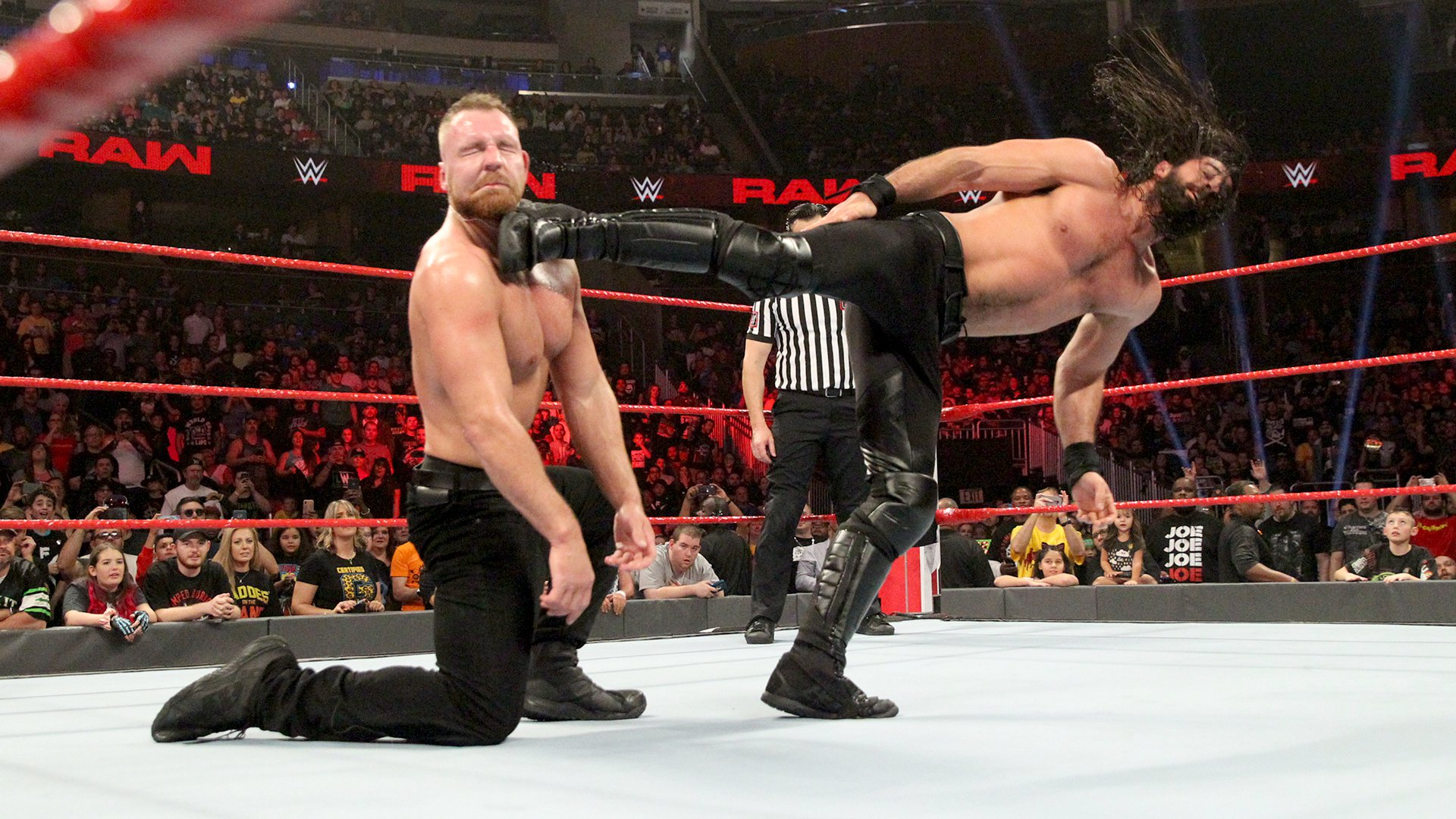 Rollins tattoos Ambrose with a kick...