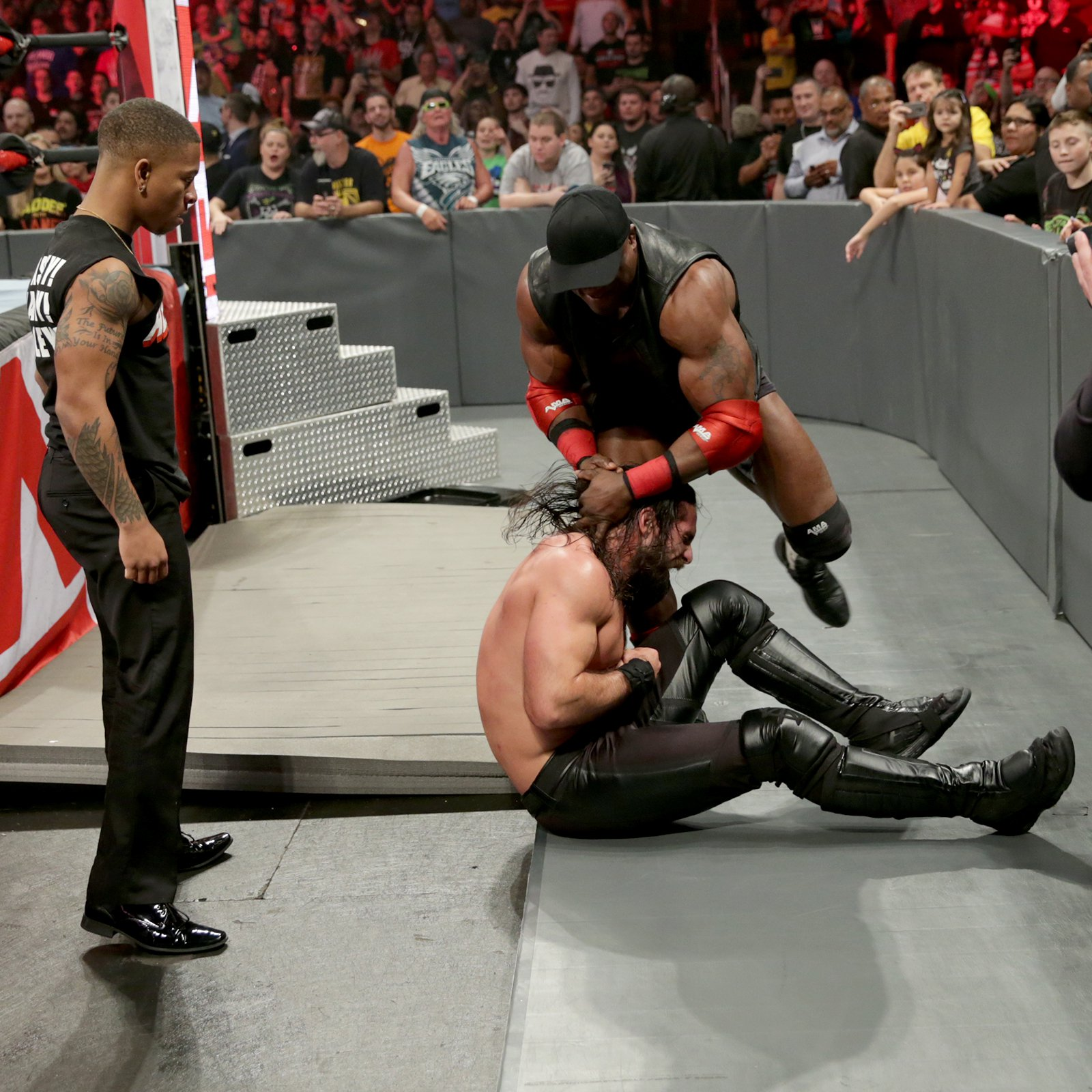 """Suddenly, """"The All Mighty"""" Bobby Lashley attacks Rollins!"""