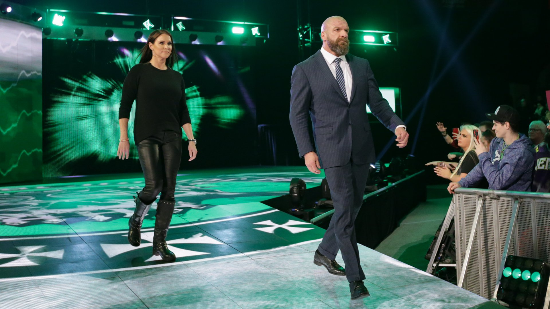 Triple H and Stephanie McMahon prepare to confront Lynch.