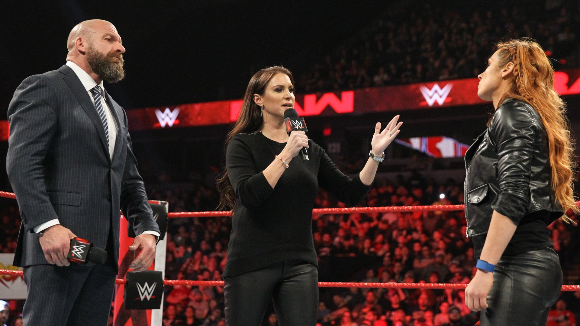 "Triple H and Stephanie want to know if Becky is going to ""say those two little words or throw away your moment in history."""