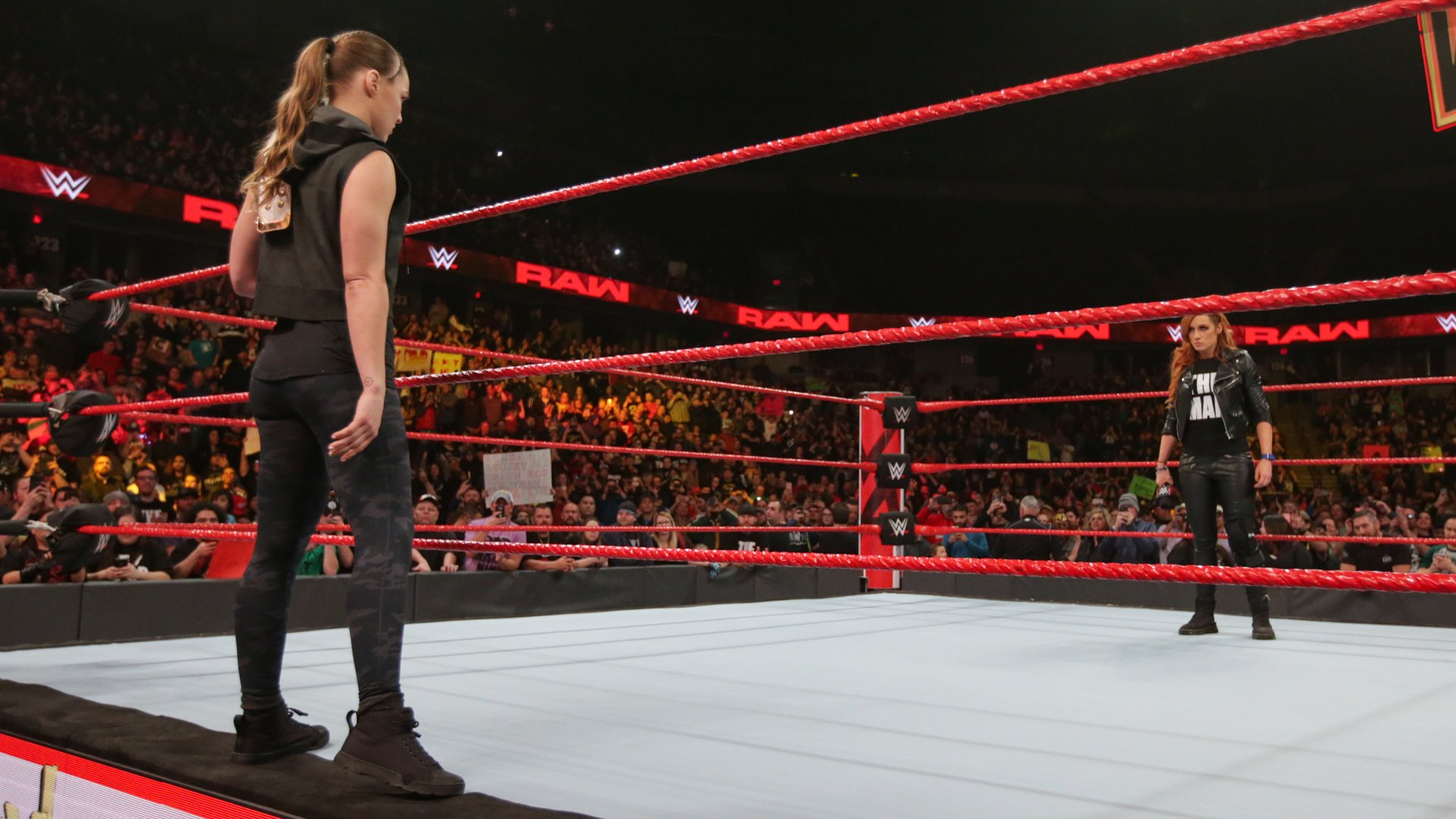 Suddenly, Raw Women's Champion Ronda Rousey hits the scene!
