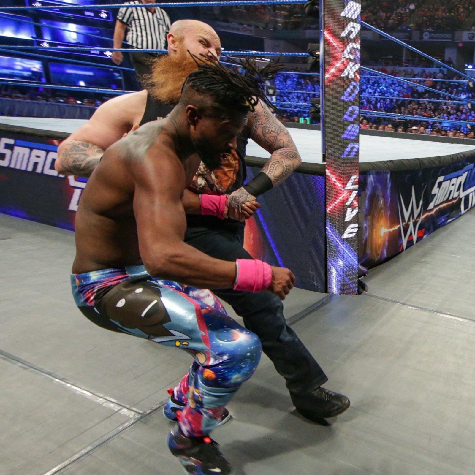 Rowan gets disqualified for striking Kofi with a steel chair...