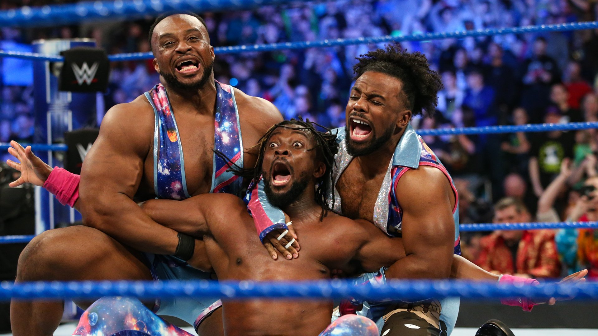 Big E and Xavier Woods hit the ring to start the celebration!
