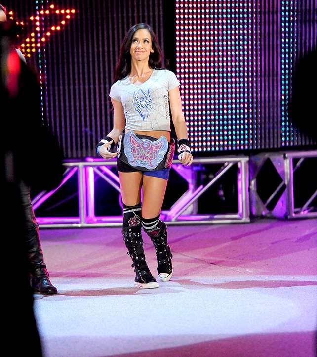 A confident AJ Lee proudly wears her Divas Championship to the ring at Elimination Chamber.