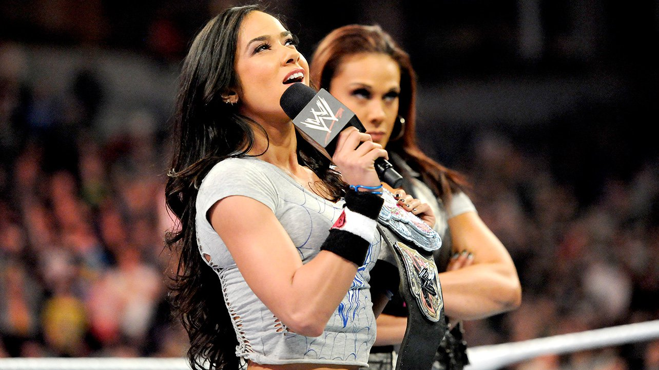 "With Tamina Snuka by her side, AJ tells the WWE Universe that she has ""zero competition"" for her title and points out she's the longest-reigning Divas Champion of all time at 252 days (and counting)."