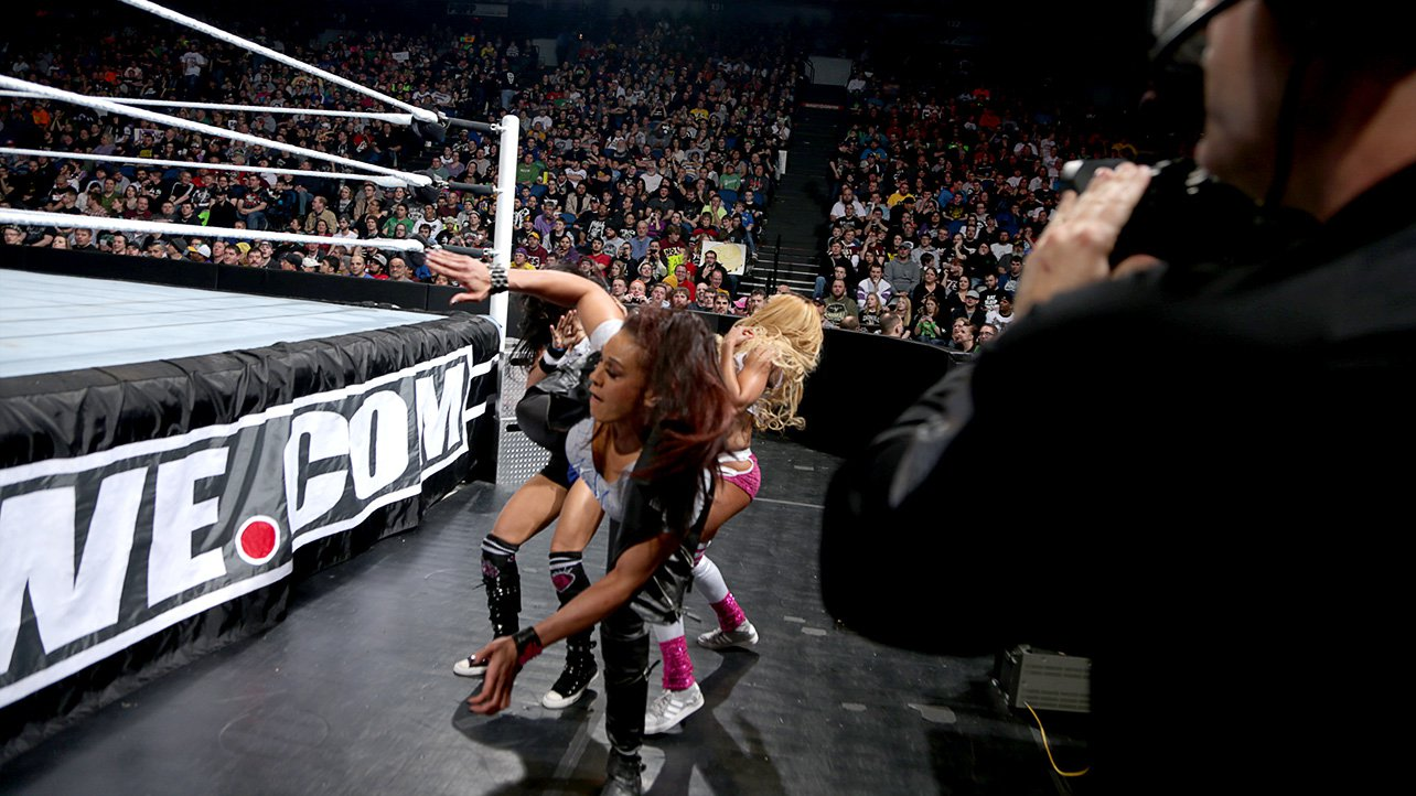 When the action spills outside the ring, the tide turns in the lucky  Funkadactyl's favor when Tamina accidentally superkicks AJ.