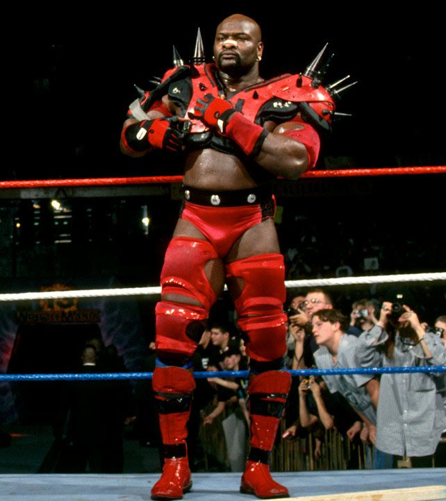 Ahmed Johnson put on Legion of Doom's famous spiked shoulder pads for a Six-Man Street Fight at WrestleMania 13.