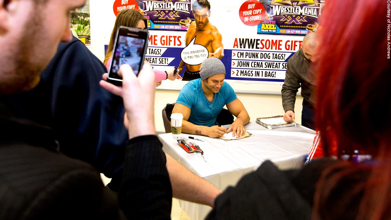 Fandango meets and signs autographs for many more members of the WWE Universe.