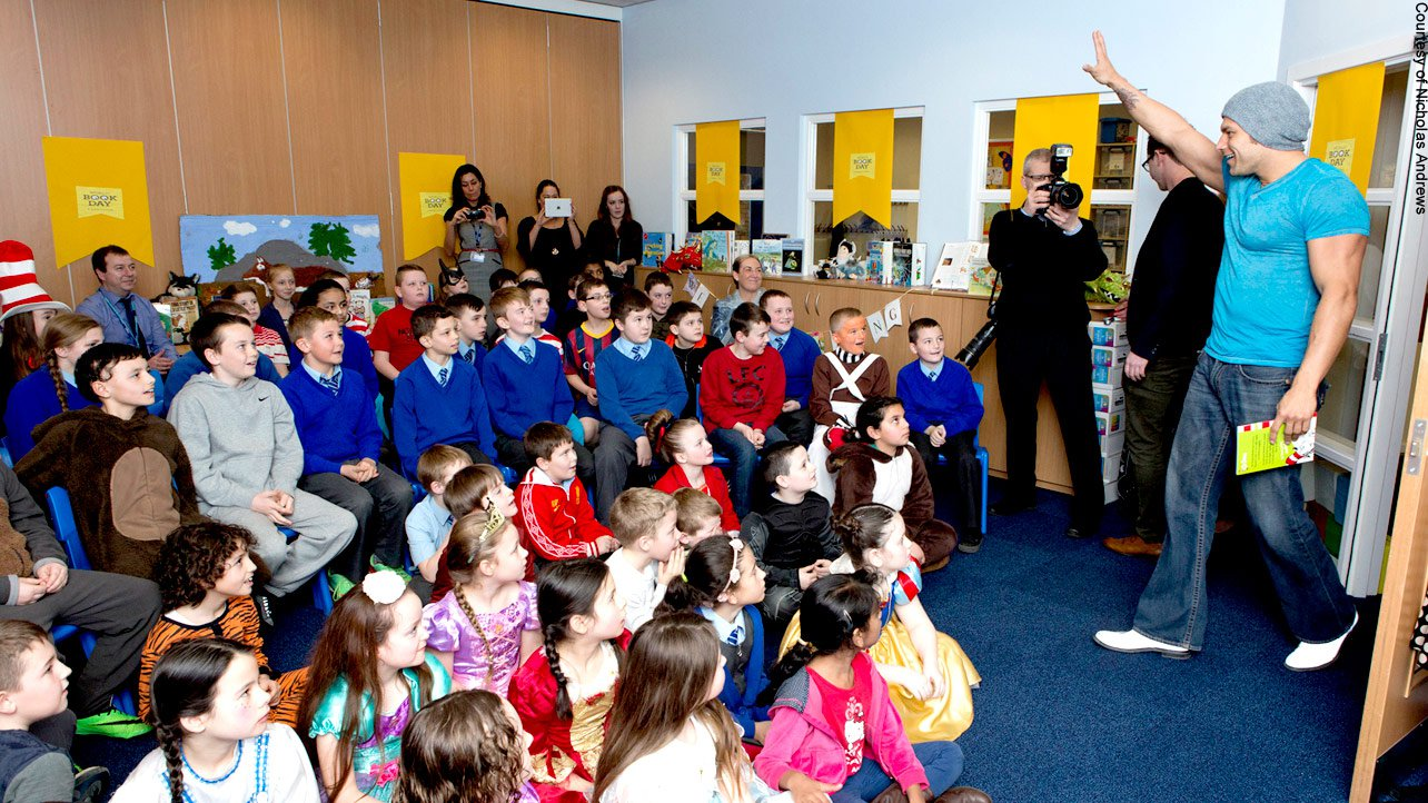 Later, the dancing Superstar drops by a school for World Book Day to spend time with students.