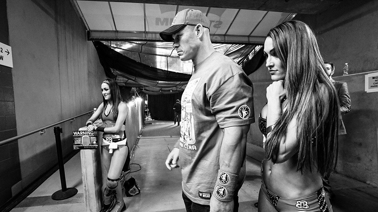 Sunday, March 29 – 5:18 p.m.: Brie Bella, Nikki Bella and John Cena watch the action from backstage before their respective matches.