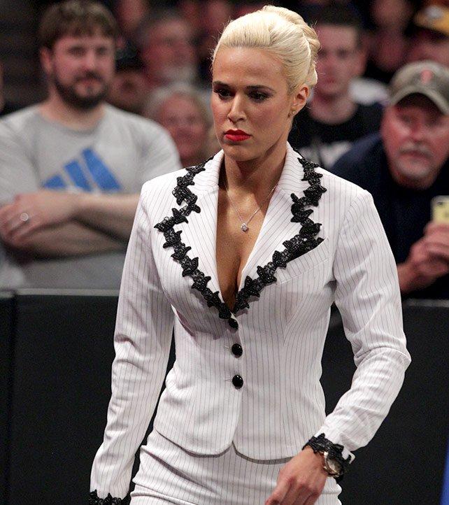 Insulted, Lana slinks back to the locker room.