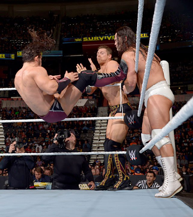 Neville displays his incredible agility and takes down The Miz and Bo Dallas.