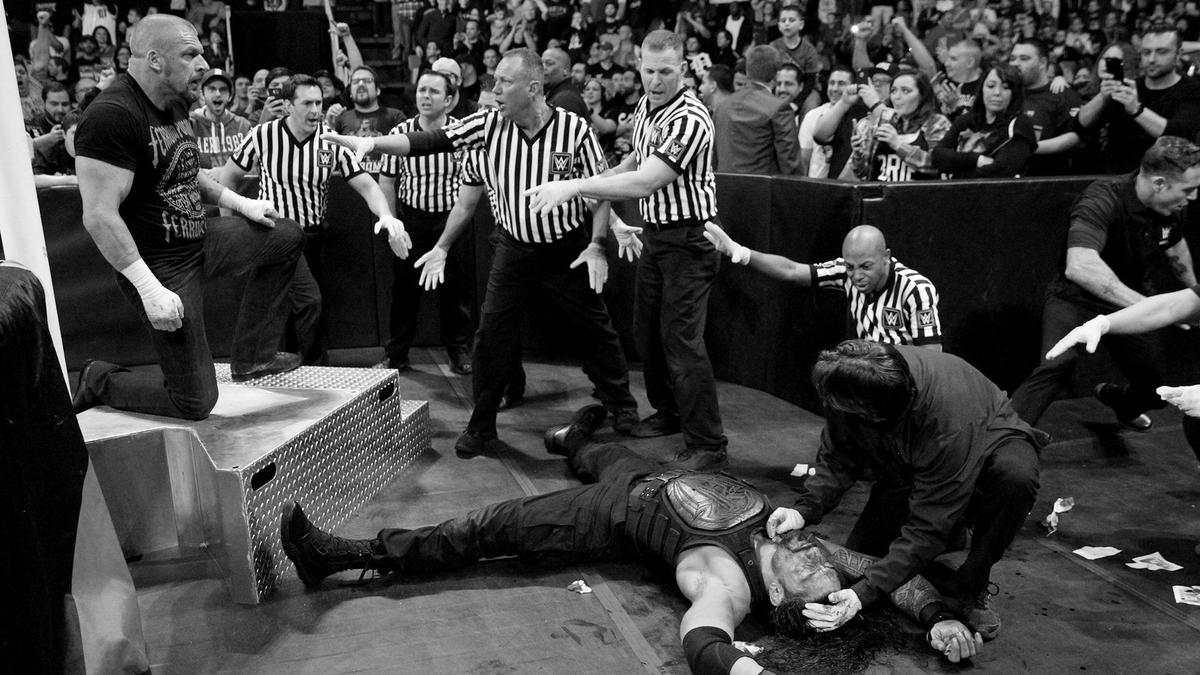 Triple H punctuates the beating with a Pedigree onto the steel steps, though.