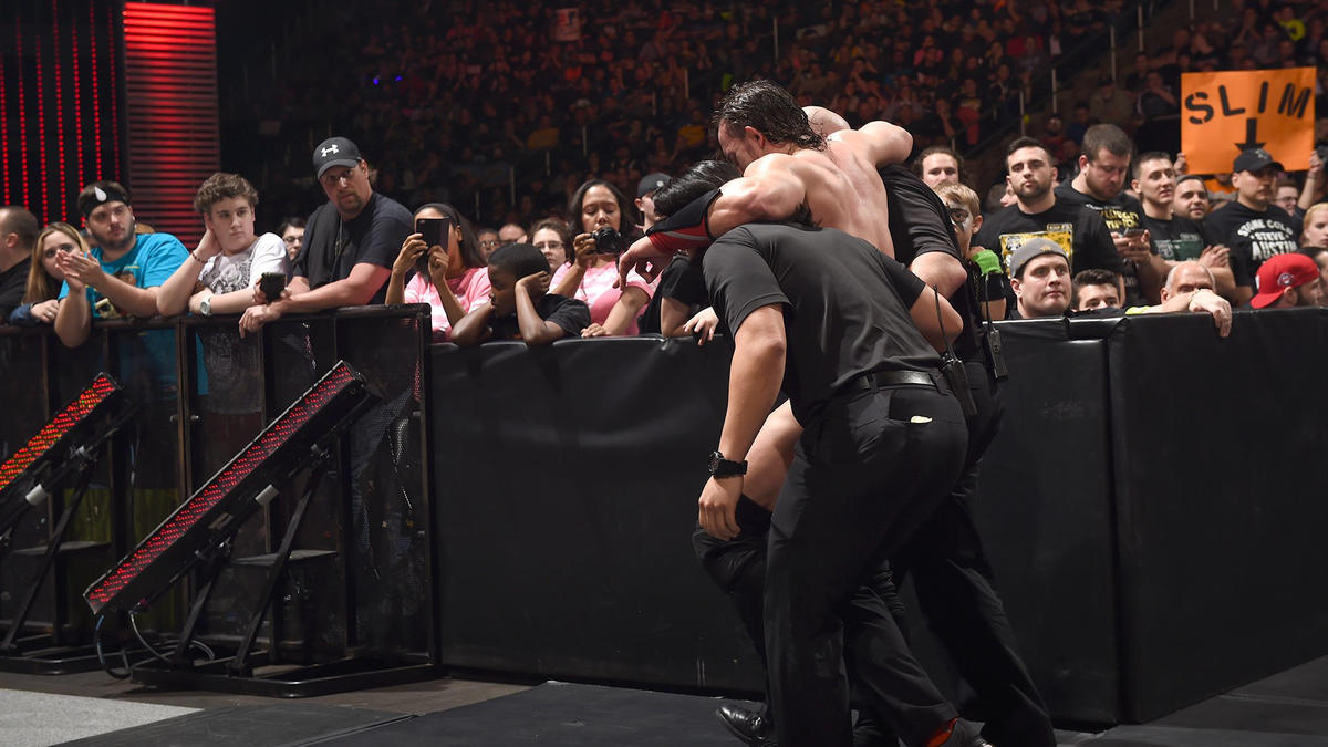 Jericho loses by disqualification and trainers help Neville out.