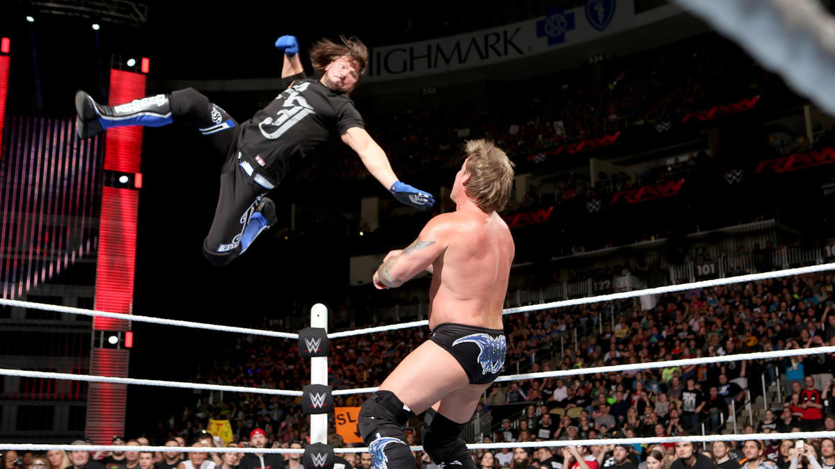 Styles rushes to the ring and drops Jericho with a Phenomenal Forearm.
