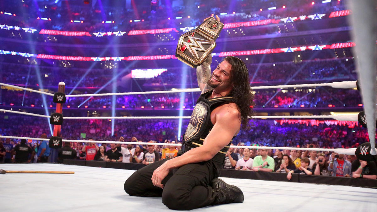 After evading Triple H's sledgehammer and scoring with a Spear, Reigns claims the WWE World Heavyweight Title.