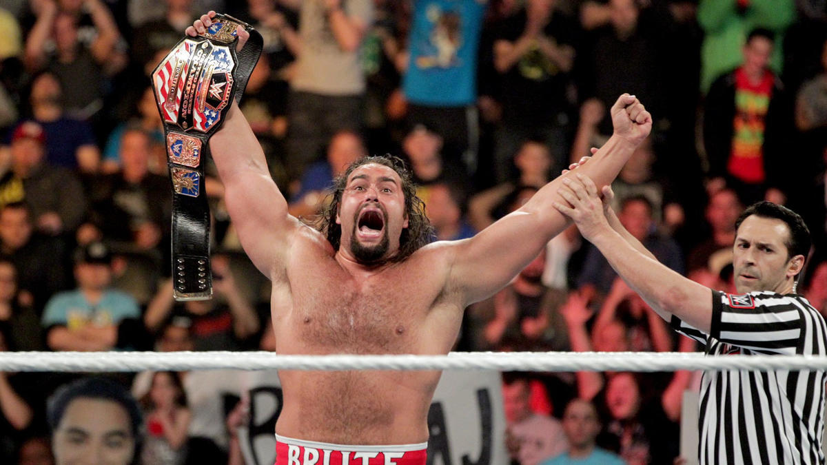 Rusev celebrates after forcing his opponent to tap out to a wince-inducing Accolade.