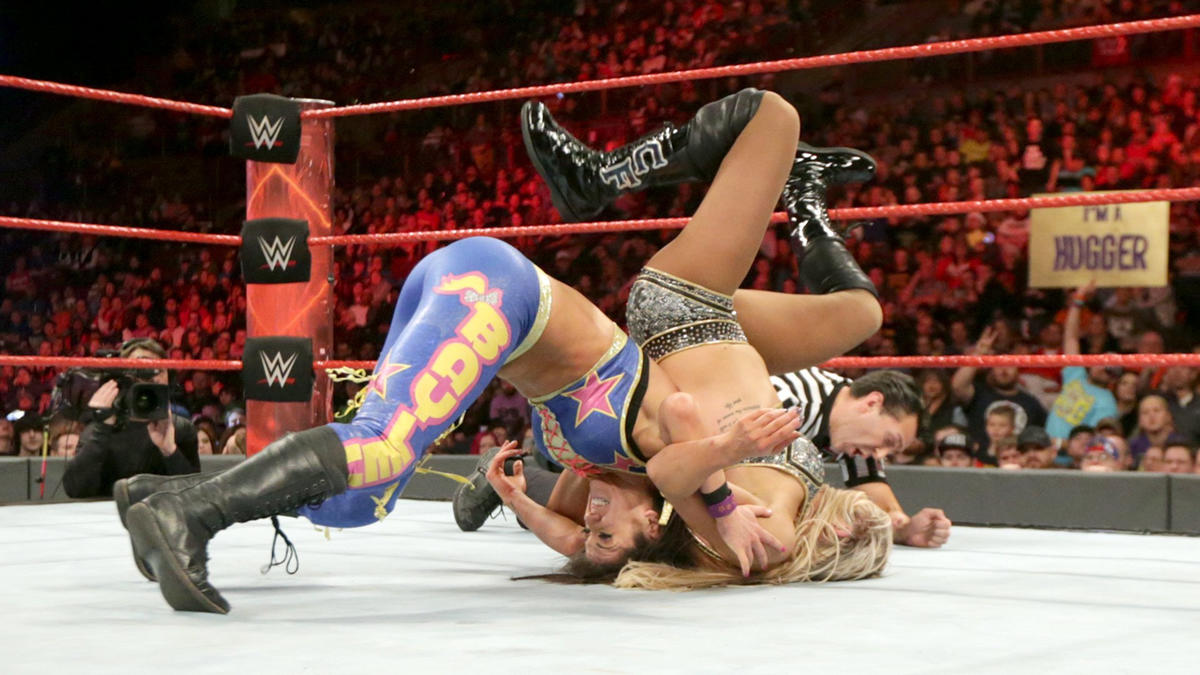 The referee counts to three and awards the match to Bayley, though a replay reveals Charlotte's right shoulder was off the mat during the pinfall.