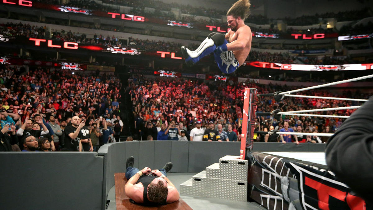 In one of the more harrowing maneuvers of the night, The Phenomenal One nails a 450 Splash on Ambrose as he lies on a table outside the ring.