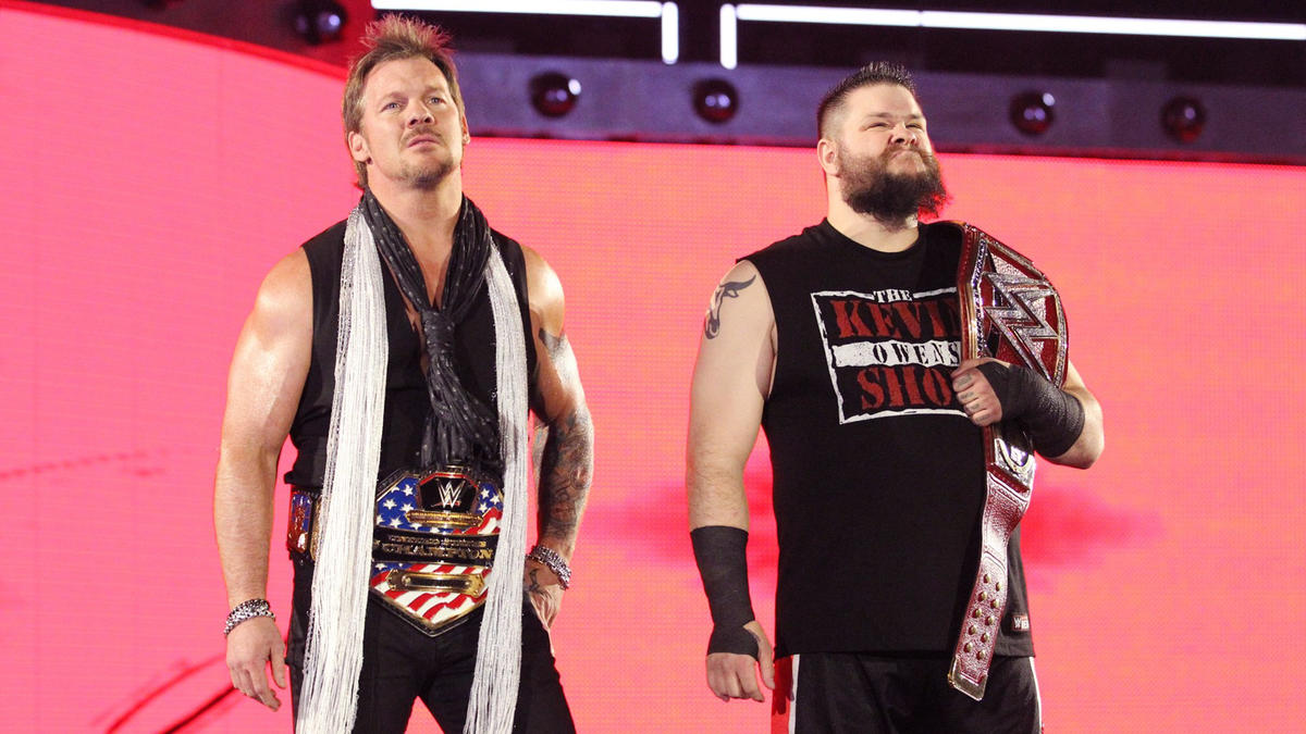 Jericho and Owens scope out the cage as they make their way to the ring.