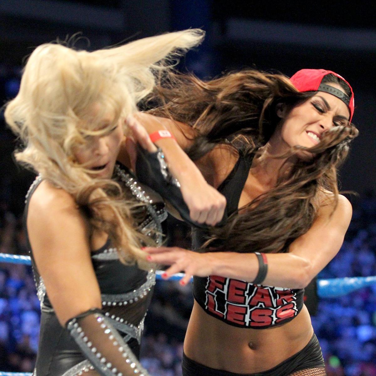 Nikki has heard enough and decks Natalya!
