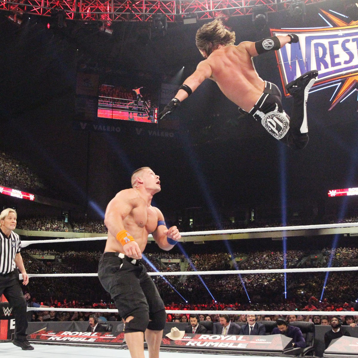 Styles soars high to increase the impact of his Phenomenal Forearm.
