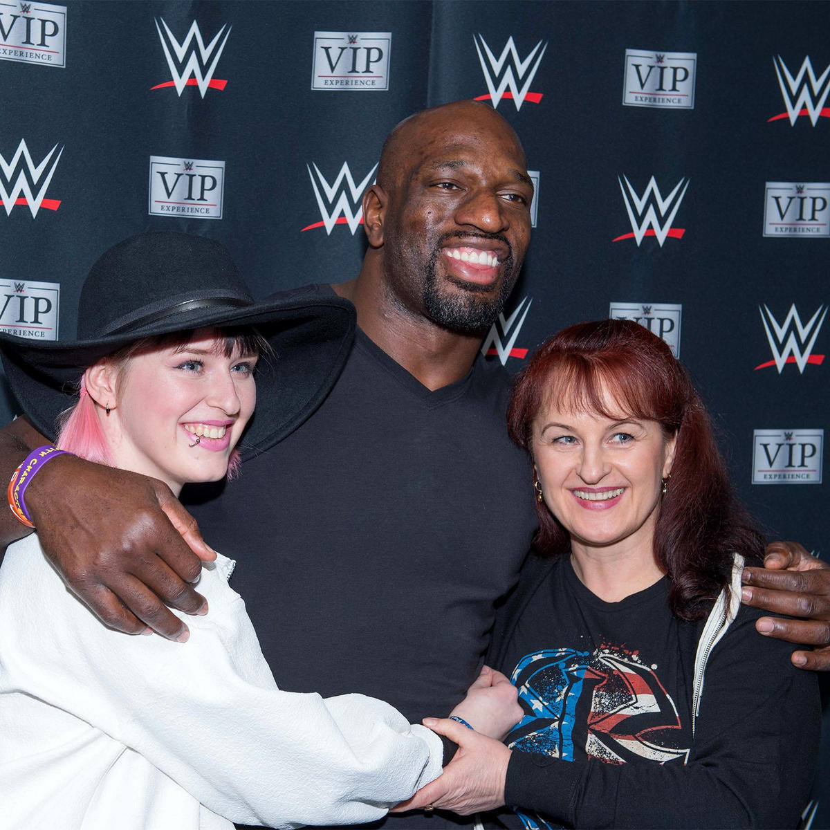 Wwe superstars visit hannover germany photos wwe titus oneil snaps a pic with some of the wwe universe members in hannover m4hsunfo