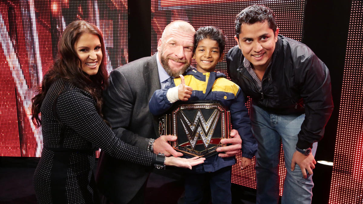 Celebrities meet superstars backstage at raw in los angeles photos stephanie and the game even present him with an honorary wwe championship m4hsunfo