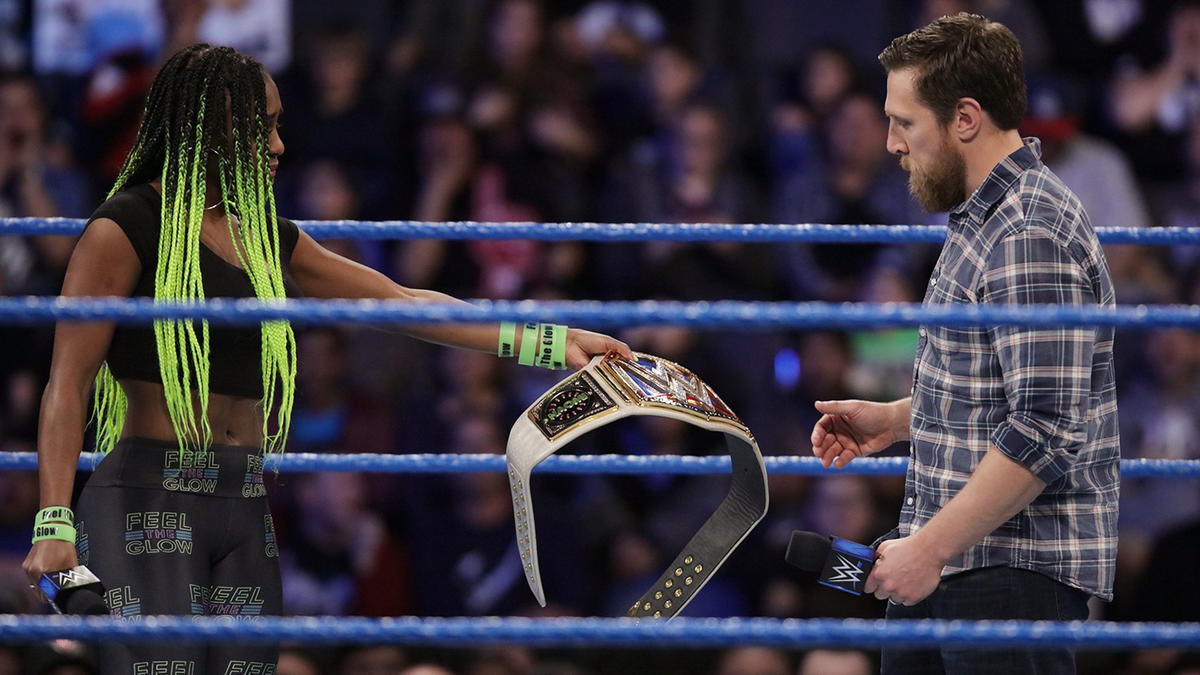 """I know that when I give you this title, that right there,"" she says, referring to the WrestleMania sign, ""is probably gone, too."""