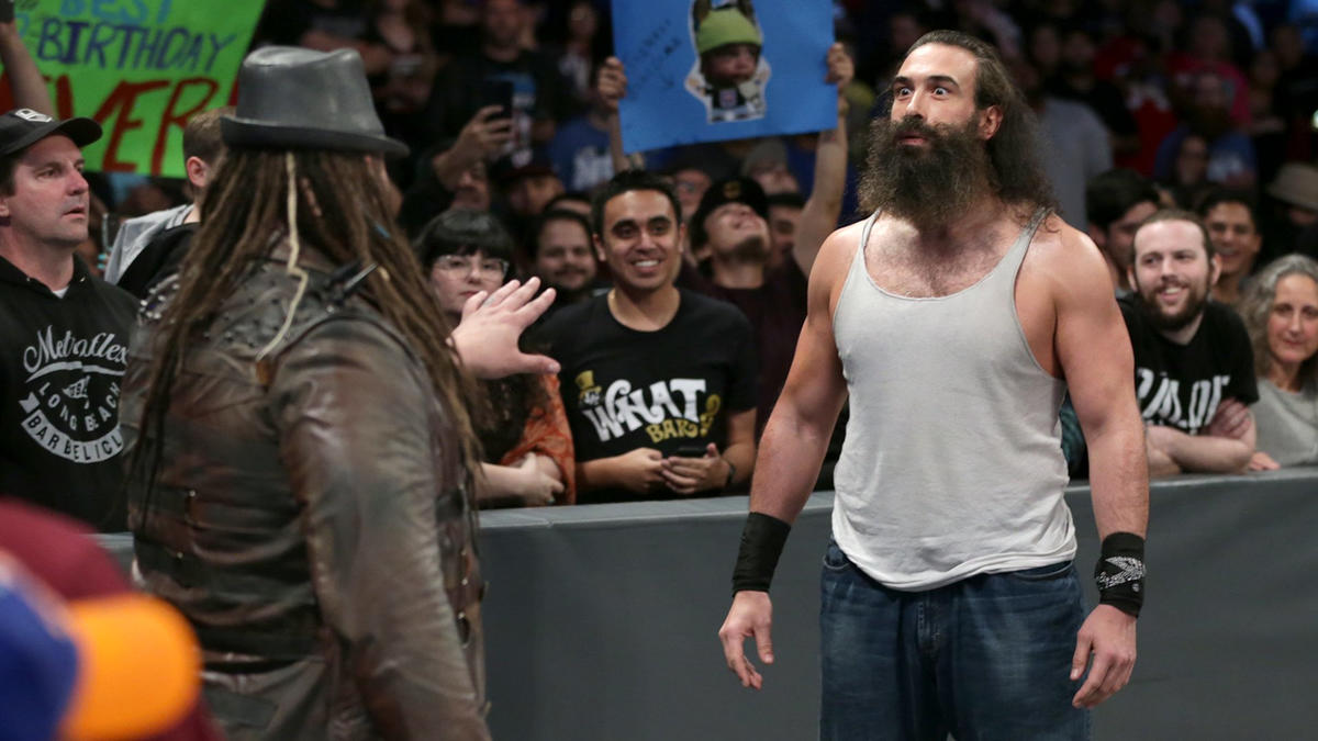 On his way to the ring, he runs into his former follower, Luke Harper.