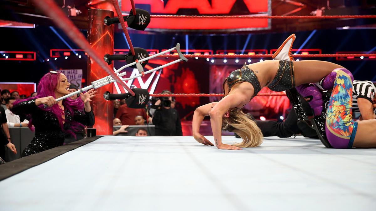 Sasha Banks arrives to take out Dana Brooke. She breaks up the Figure-Four Leglock.