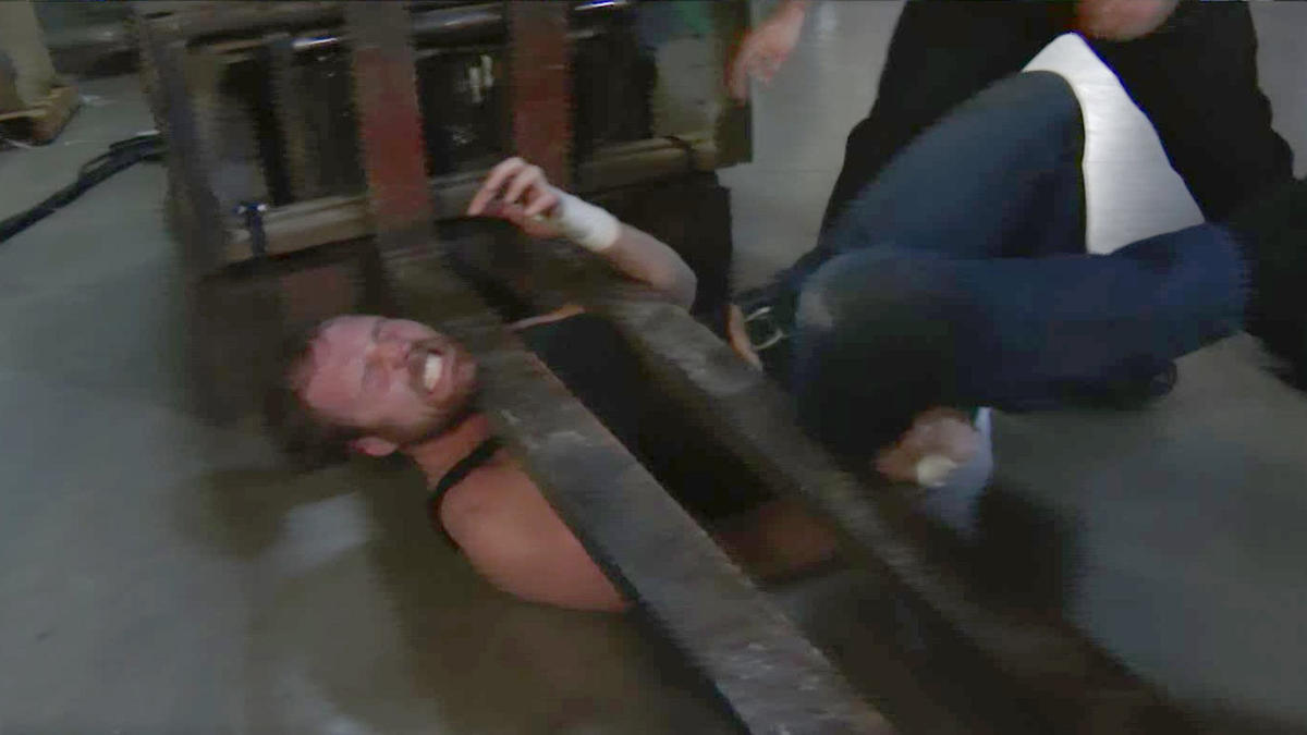 The Lone Wolf pins The Lunatic Fringe under a forklift!