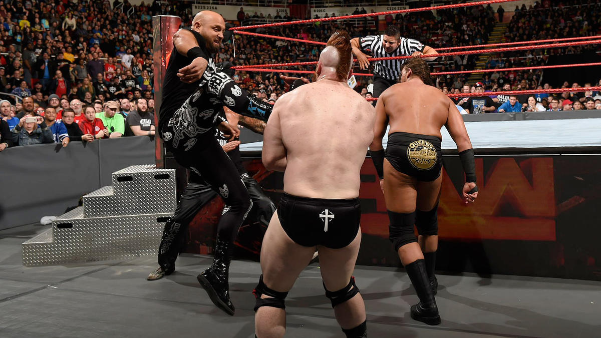 Karl Anderson and Luke Gallows attack Cesaro & Sheamus.