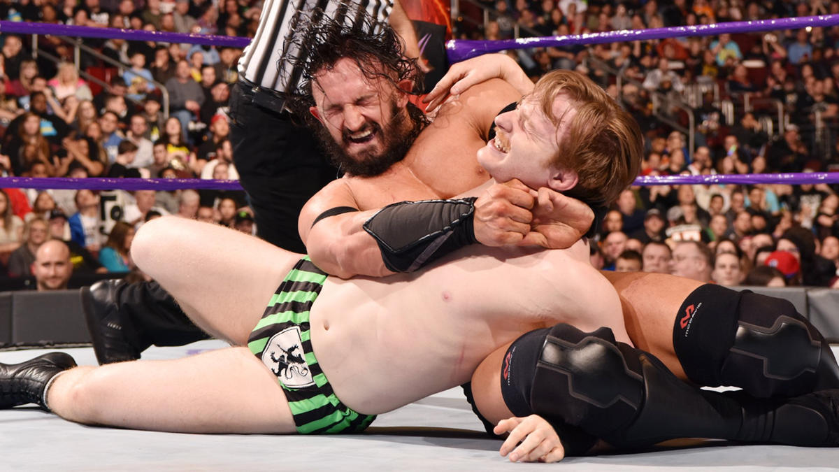 Neville scores a submission victory over Gallagher.