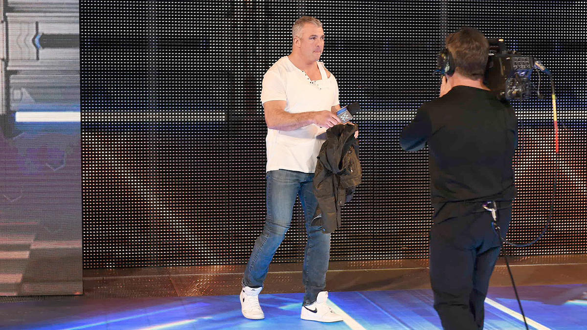 Shane McMahon makes his way to the stage to address AJ Styles.