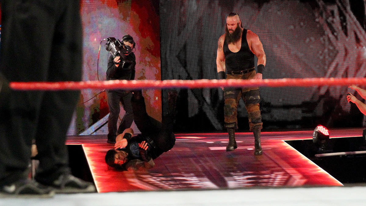 Strowman bowls over Reigns at the top of the stage.
