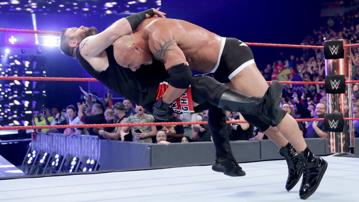 Distracted by the arrival of Y2J, Owens takes his eyes off Goldberg and gets crushed with a Spear.
