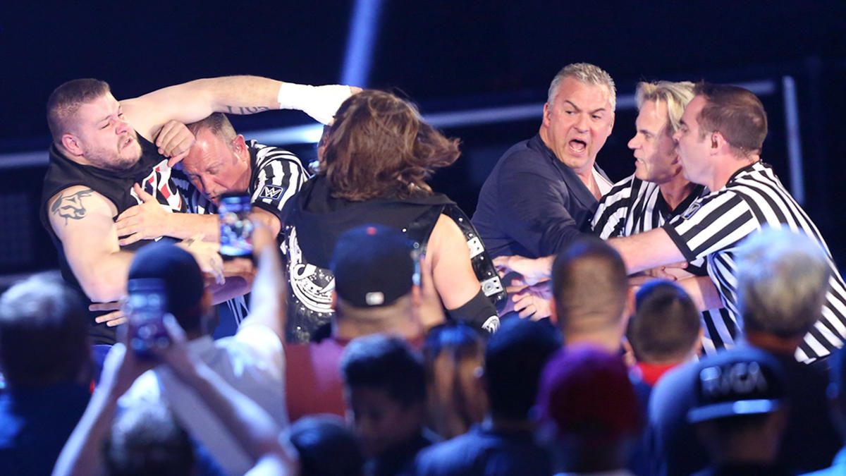 The Prizefighter and AJ Styles need to be separated by Shane McMahon and officials.