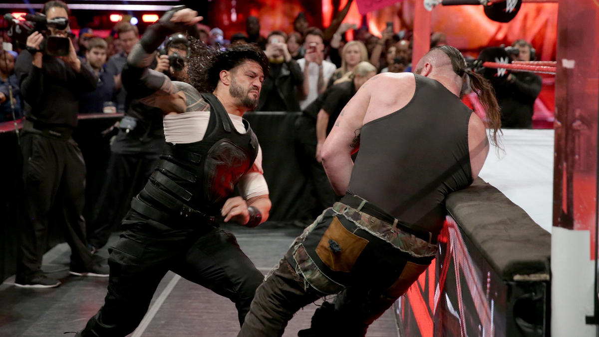 The brawl spills to the outside where Reigns continues to hammer away on Strowman.