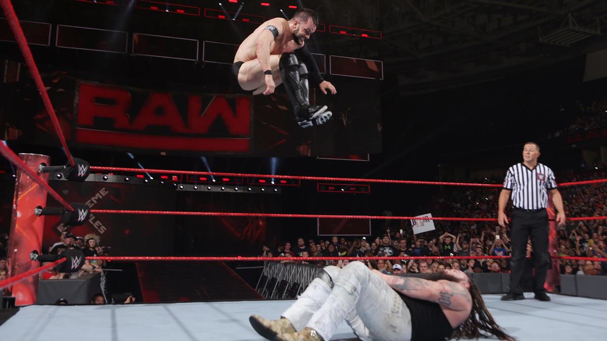 Bálor lands the Coup de Grace on Wyatt...