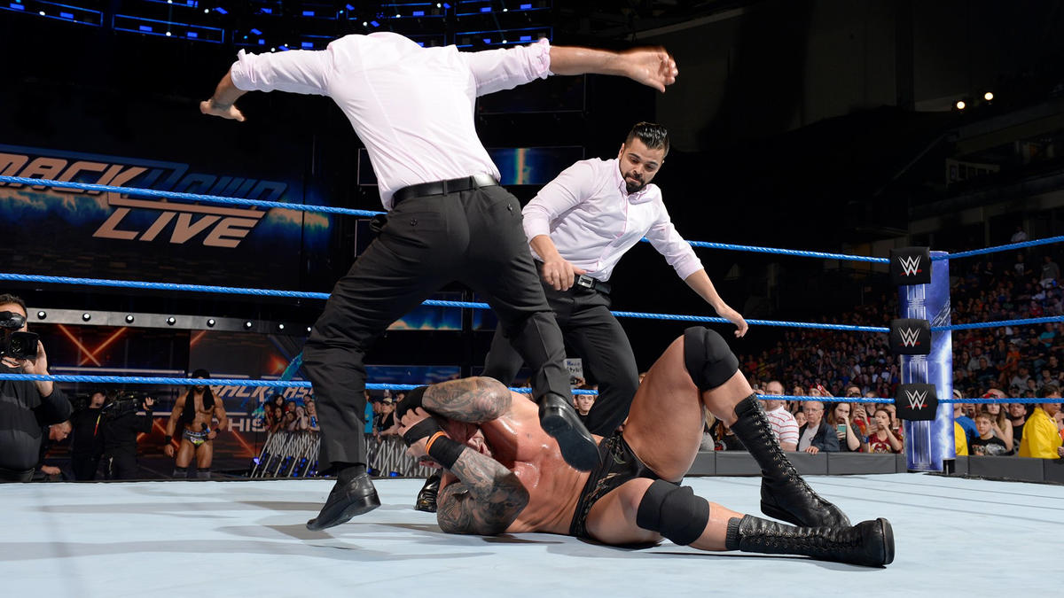 ... and The Singh Brothers pounce on a distracted Orton!