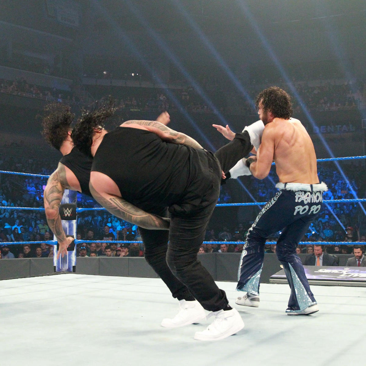 The Usos drill Fandango with a double superkick.