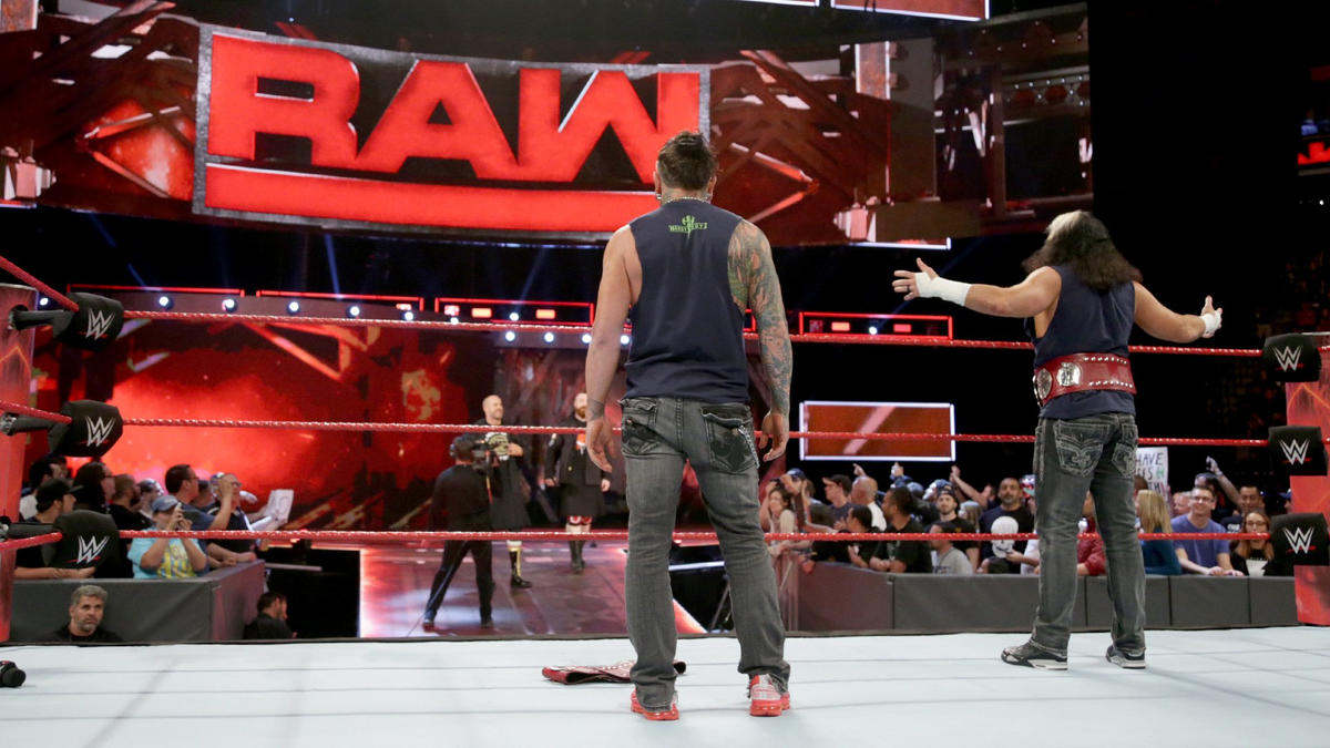 The Raw Tag Team Champions rush the ring, but Cesaro and Sheamus hit the road.