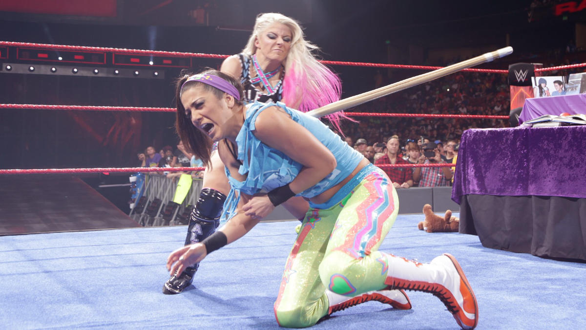 Little Miss Bliss once again nails Bayley with the Kendo stick.