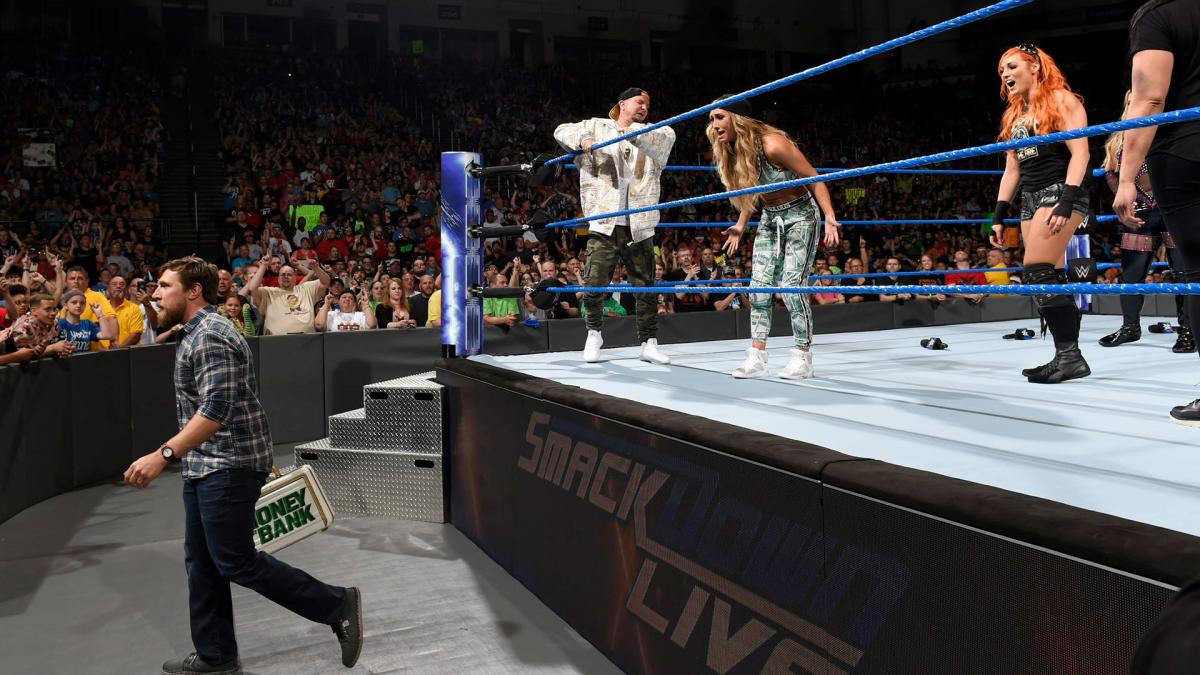 Bryan nullifies Carmella's victory and exits with the briefcase.