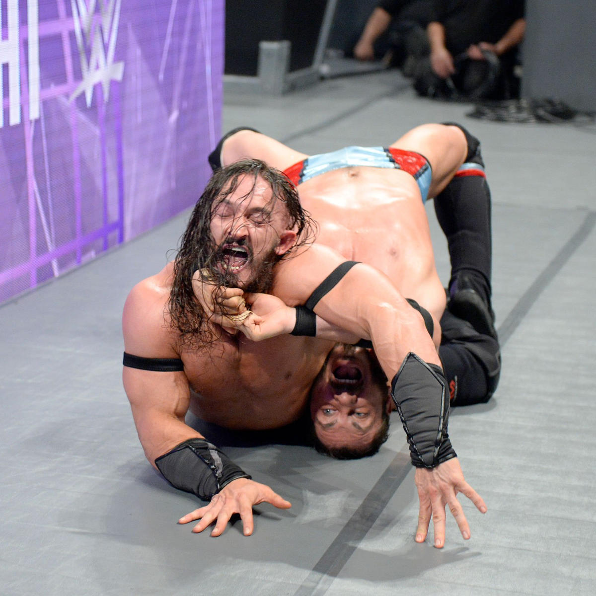 Neville taps out to The Last Chancery, but escapes defeat because Aries must win in the ring.