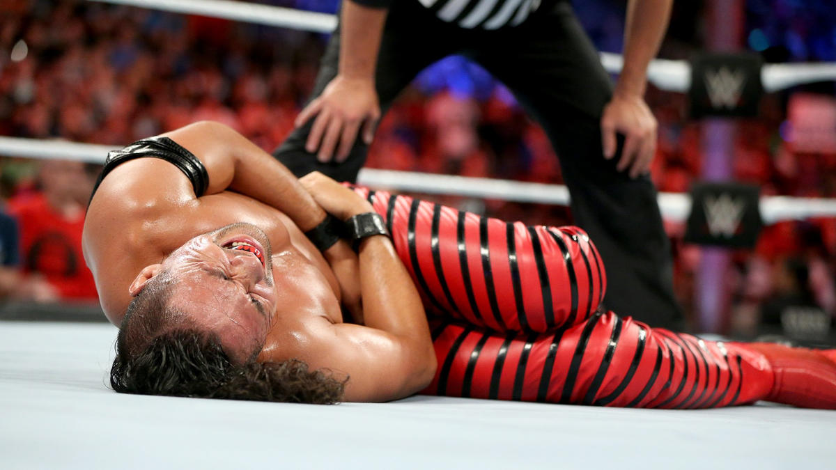 Corbin hits Nakamura with a low blow, giving a disqualification victory to his opponent.